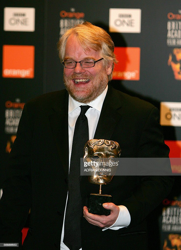 Actor Phillip Seymour Hoffman poses for photographs after winning the 'Best Actor' award after starring in the film 'Capote' at the British Academy...
