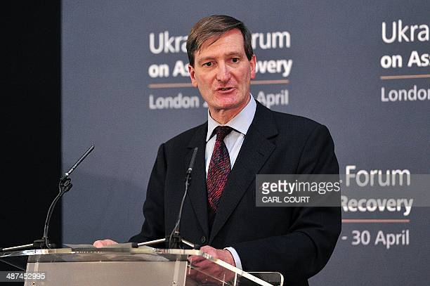 United Kingdom Attorney General Dominic Grieve gives his closing statement at the end of the Ukrainian Forum on Asset Recovery in London on April 30...