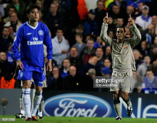 Barcelona's Ronaldinho celebrates scoring his second goal as Chelsea's Paulo Ferreira walks to his position during their second leg Champion's League...