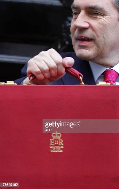 Britain's Chancellor of the Exchequer Gordon Brown shows his red attache case as he leaves 11 Downing Street in London 21 March 2007 Brown prepares...