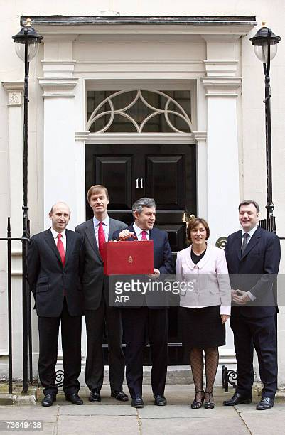 Britain's Chancellor of the Exchequer Gordon Brown shows his red attache case as he leaves 11 Downing Street in London with the members of the...