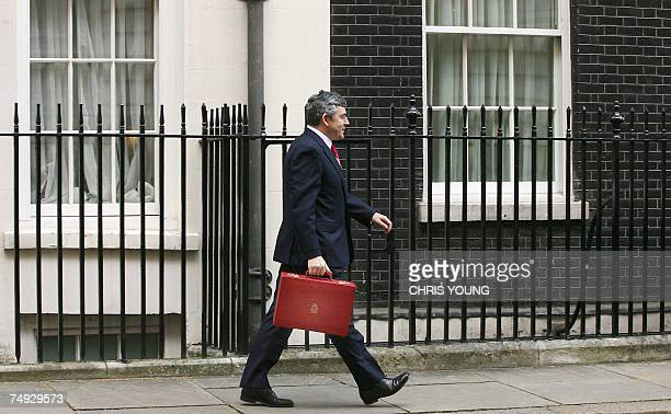 Britain's Chancellor of the Exchequer Gordon Brown holds his red attache case as leaves 11 Downing Street in London 21 March 2007 Brown prepares to...