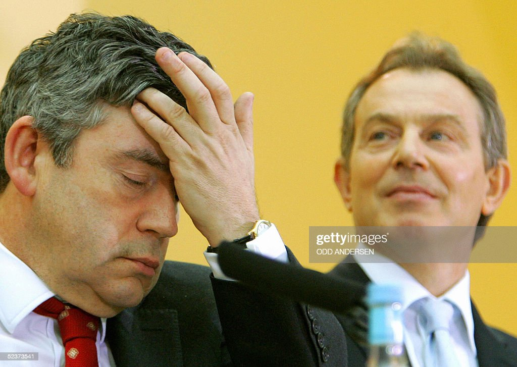 Britain's Prime Minister Tony Blair (R) and Chancellor of the Exchequer Gordon Brown attend the release of the Africa Commission documents at the British museum in London, 11 March, 2005. A panel chaired by British Prime Minister Tony Blair called for the international community to spend an extra 25 billion dollars (19 billion euros) a year for the next three to five years to finance urgent reforms in Africa.