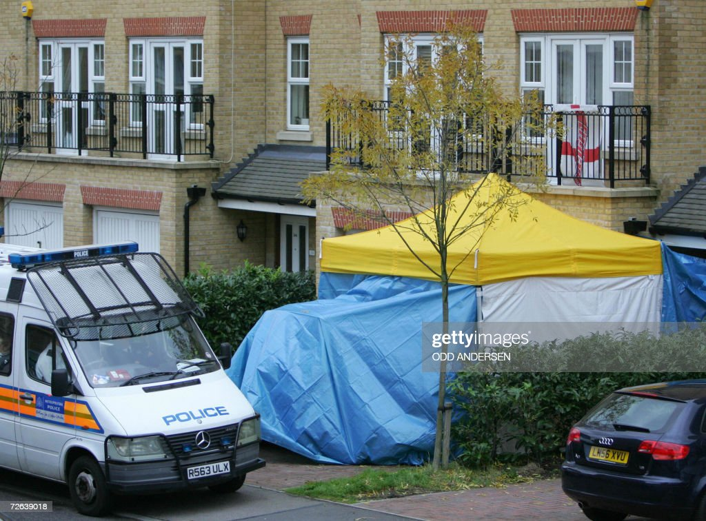 British police guard the entrance to the home of former Russian spy Alexander Litvinenko in north London, 24 November 2006. Former spy Alexander Litvinenko was probably poisoned by radioactive polonium 210, British public health body the Health Protection Agency said Friday. Professor Roger Cox, from the HPA's Centre for Radiation, Chemicals and Environmental Hazards, told a central London news conference that a 'large quantity' of alpha radiation 'probably from a substance called polonium 210' had been detected in Litvinenko's urine.