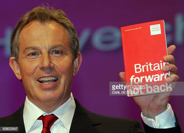 British Prime Minister Tony Blair holds up the Labour Party election manifesto 13 April 2005 in London Blair confirmed that he would step down as...