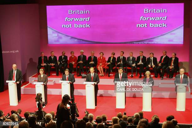 British Prime Minister Tony Blair outlines the Labour Party election manifesto as the enitire Labour cabinet looks on 13 April 2005 in London Blair...