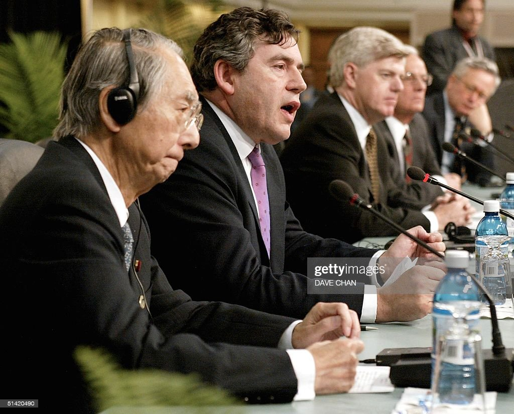 United Kingdom Chancellor of the Exchequer Gordon Brown speaks to reporters as Japanese Minister Masajuro Shiokawa Canadian Minister John Manley US...