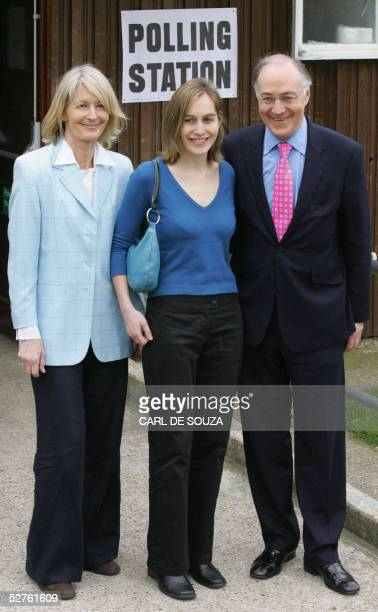 Conservative Party Leader Michael Howard poses with wife Sandra and daughter Larissa outside his local polling station in Lympney England 05 May 2005...