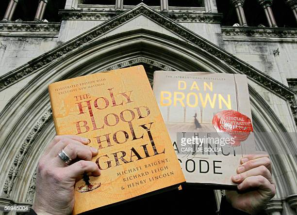 Copies of the books the 'The Da Vinci Code' by Dan Brown and 'Holy Blood Holy Grail' by Richard Leigh and Michael Baigent are held infront of the...