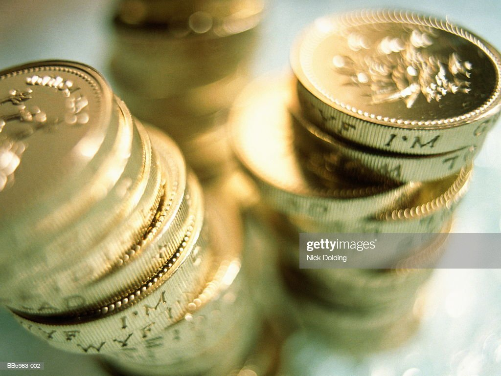 United Kingdom currency, one pound coins, close-up : Stock Photo