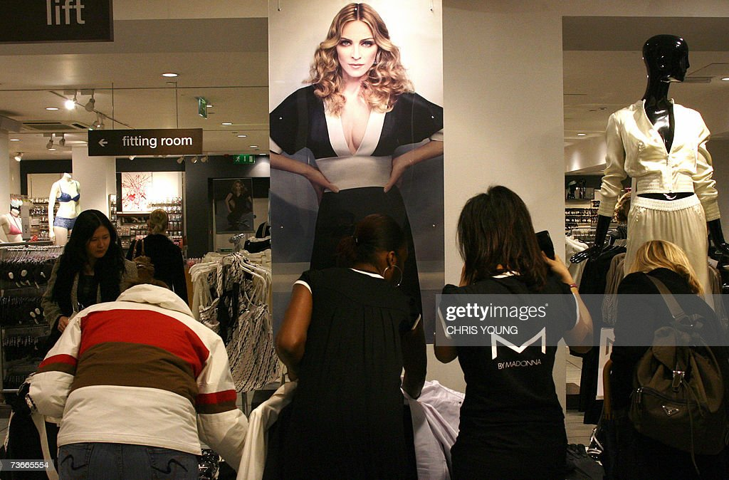 Customers at a London 'H&M' store get a first look at <a gi-track='captionPersonalityLinkClicked' href=/galleries/search?phrase=Madonna+-+Singer&family=editorial&specificpeople=156408 ng-click='$event.stopPropagation()'>Madonna</a>'s new High Street fashion range, 22 March 2007. A new clothing line designed by <a gi-track='captionPersonalityLinkClicked' href=/galleries/search?phrase=Madonna+-+Singer&family=editorial&specificpeople=156408 ng-click='$event.stopPropagation()'>Madonna</a> for Swedish cheap-chic retailer H&M, dubbed 'M by <a gi-track='captionPersonalityLinkClicked' href=/galleries/search?phrase=Madonna+-+Singer&family=editorial&specificpeople=156408 ng-click='$event.stopPropagation()'>Madonna</a>' and put on sale around the world, included Kimono dresses, skintight pants, pencil skirts, tight-fitting blouses, as well as accessories including wide belts, purses and high-heeled shoes. AFP PHOTO/Chris Young