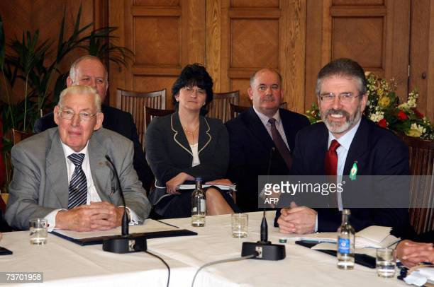 Democratic Unionists leader Ian Paisley and Sinn Fein chief Gerry Adams speak to the media during a press conference at the Stormont Assembly...
