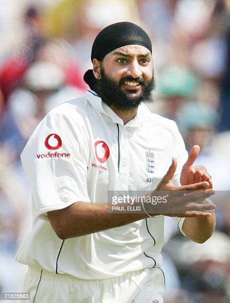 England bowler Monty Panesar celebrates taking the wicket of Pakistan's Faisal Iqbal on the first day of the second cricket Test match at Old...