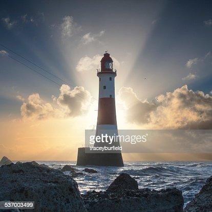 United Kingdom, England, East Sussex, Beachy Head, Beachy Head Lighthouse backlit by rising sun