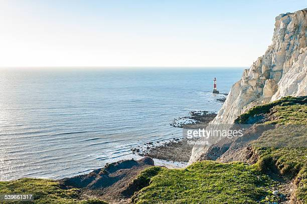 United Kingdom, England, East Sussex, Beachy Head lighthouse with Seven Sisters cliff in foreground