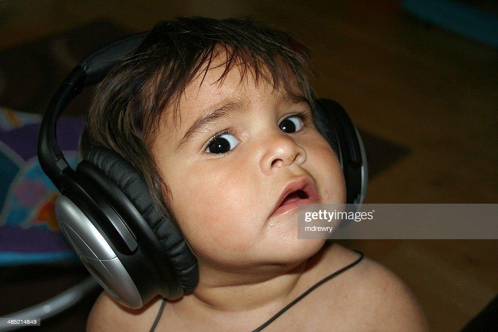 United Kingdom, England, London, Portrait of little boy using headphones : Stock Photo