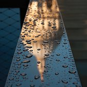 United Kingdom, England, London, Raindrops and reflection of St Pauls Cathedral on metal railing of One New Change building