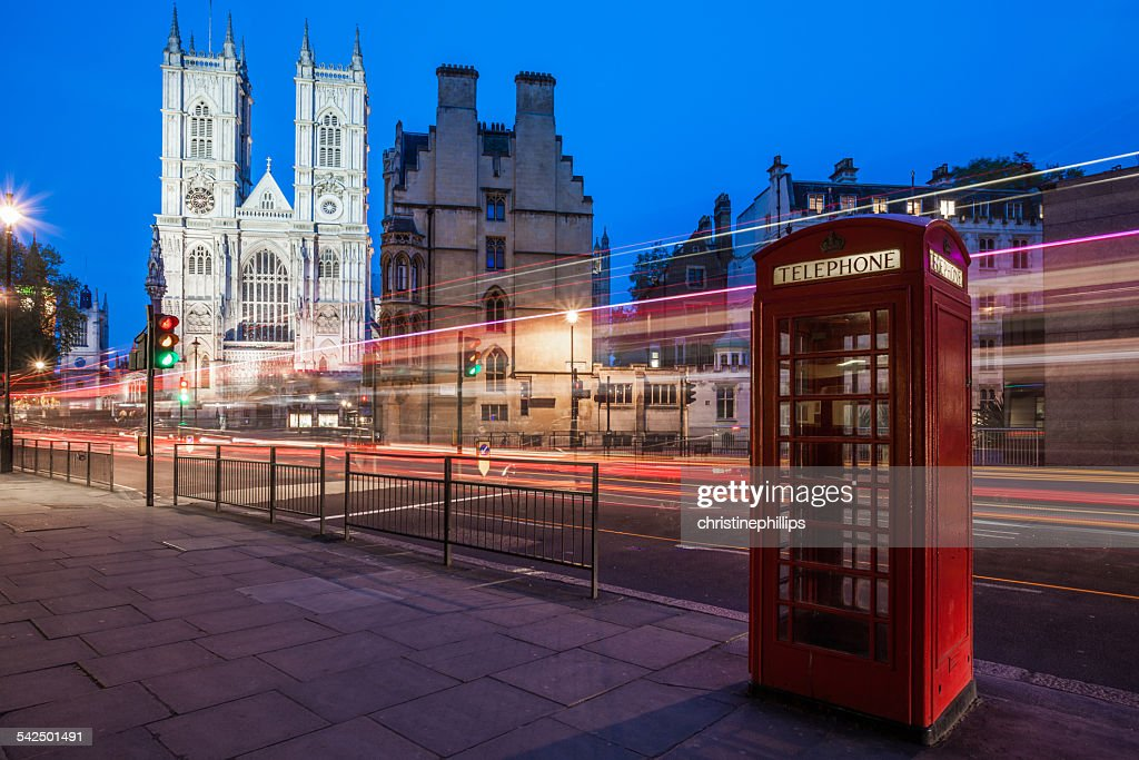 United Kingdom, England, London, Westminster Abbey at with light trails and red telephone box in foreground