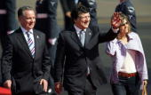 European Commission President Jose Manuel Barroso and his wife Sousa Uva accompanied by Scottish First Minister Jack Mc Connell wave to children upon...
