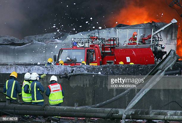 Firefighters fight a fierce fire with foam near the centre of an explosion at Buncefield oil depot in Hemel Hempstead on the outskirts of London 12...