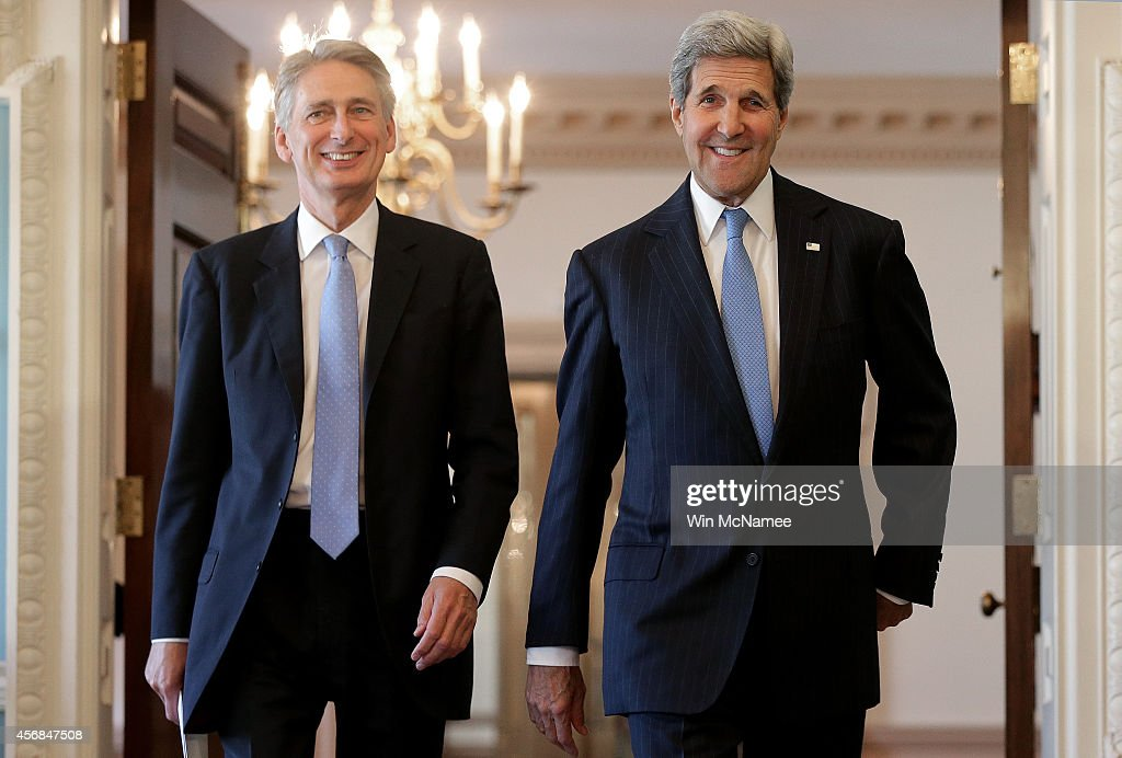 United Kingdom Foreign Minister Philip Hammond (L) and U.S. Secretary of State John Kerry (R) arrive for a joint press conference following a private meeting at the State Department October 8, 2014 in Washington, DC. Hammond and Kerry discussed strategy relating to the Islamic State in Syria and Iraq, efforts to combat the Ebola virus, and developments in Ukraine, during their remarks.