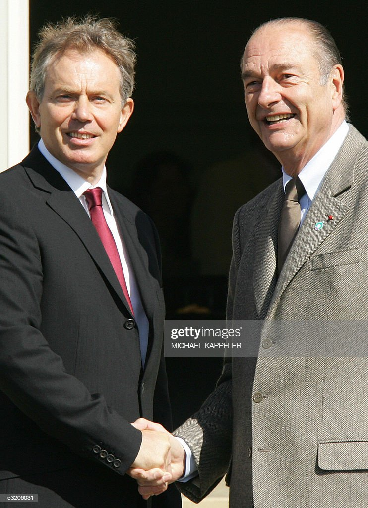 French President Jacques Chirac is greeted by British Prime Minister Tony Blair at the Gleneagles hotel 07 July 2005 during the G8 Summit Group of...