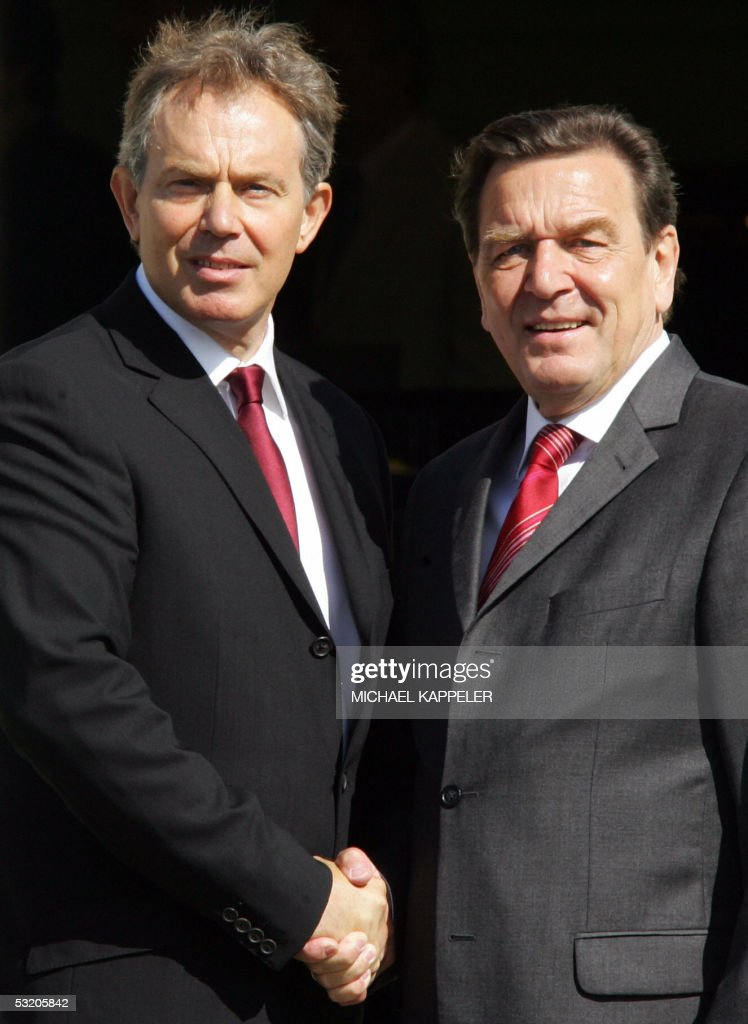 German Chancellor Gerhard Schroeder is greeted by British Prime Minister Tony Blair at the Gleneagles hotel 07 July 2005 during the G8 Summit Group...