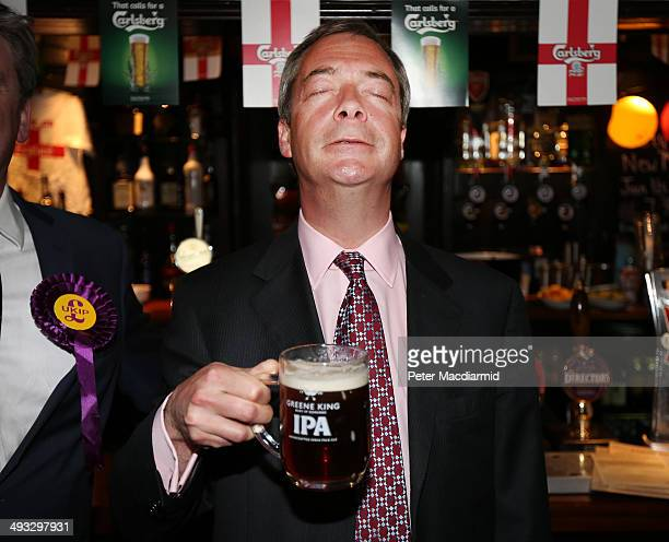 United Kingdom Independence Party leader Nigel Farage enjoys a pint of beer in a pub on May 23 2014 in Benfleet England Early local election results...