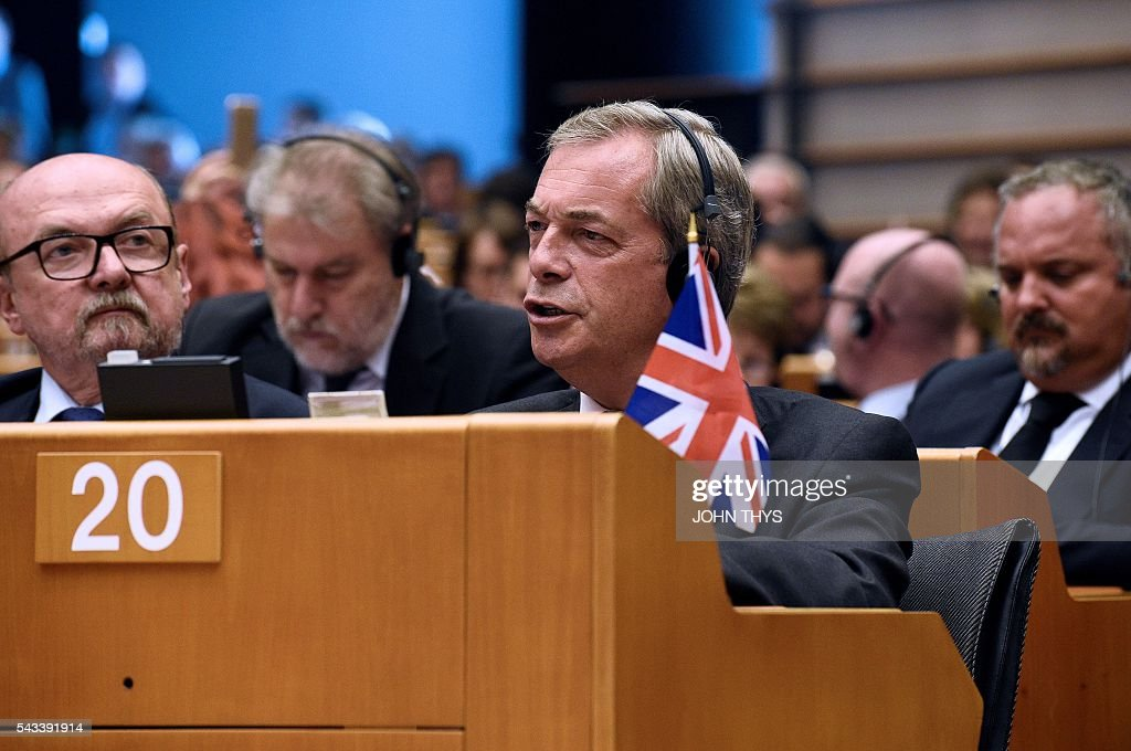 United Kingdom Independence Party (UKIP) leader Nigel Farage looks during a meeting with European Union (EU) Commission President Jean-Claude Juncker at the EU headquarters in Brussels on June 28, 2016 ahead of a plenary session. European Commission chief Jean-Claude Juncker called on June 28 on Prime Minister David Cameron to clarify quickly when Britain intends to leave the EU, saying there can be no negotiation on future ties before London formally applies to exit. European leaders gather in Brussels for a crunch two-day summit set to be dominated by Britain's departure from the bloc following its shock referendum last week. / AFP / JOHN