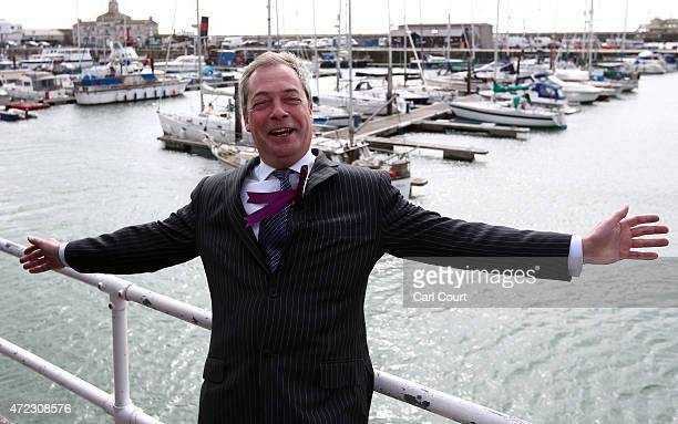 United Kingdom Independence Party leader Nigel Farage poses for a photograph next to Ramsgate Harbour on May 6 2015 in Ramsgate England Mr Farage is...