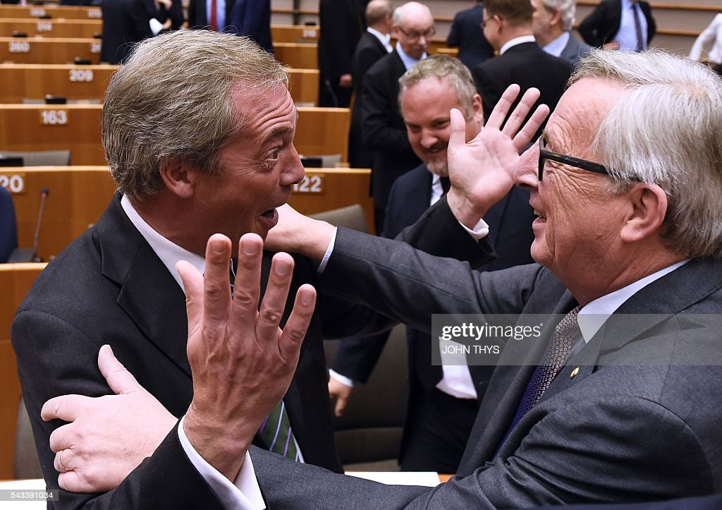 TOPSHOT United Kingdom Independence Party leader Nigel Farage reacts as he meets European Union Commission President JeanClaude Juncker ahead of a...