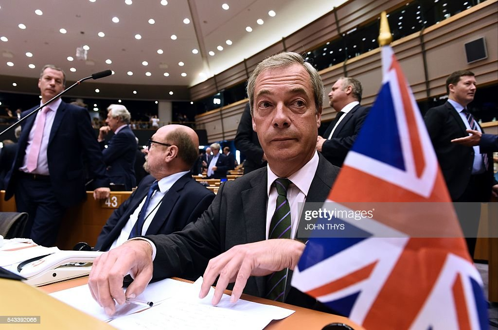 United Kingdom Independence Party (UKIP) leader Nigel Farage sits at the European Union headquarters in Brussels on June 28, 2016 for a meeting with EU Commission President Jean-Claude Juncker ahead of a plenary session. European Commission chief Jean-Claude Juncker called on June 28 on Prime Minister David Cameron to clarify quickly when Britain intends to leave the EU, saying there can be no negotiation on future ties before London formally applies to exit. European leaders gather in Brussels for a crunch two-day summit set to be dominated by Britain's departure from the bloc following its shock referendum last week. / AFP / JOHN