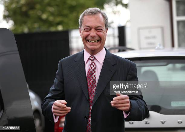 United Kingdom Independence Party leader Nigel Farage smiles as he talks to reporters on May 23 2014 near Biggin Hill England Early local election...