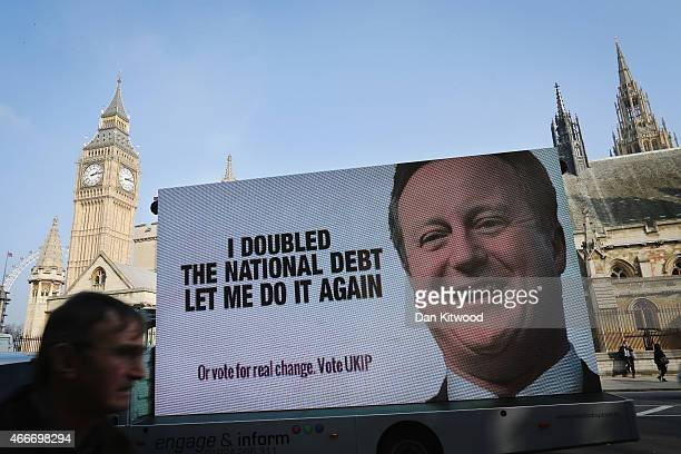 United Kingdom Independence Party political campaign poster is driven around Westminster on March 18 2015 in London England The Chancellor George...