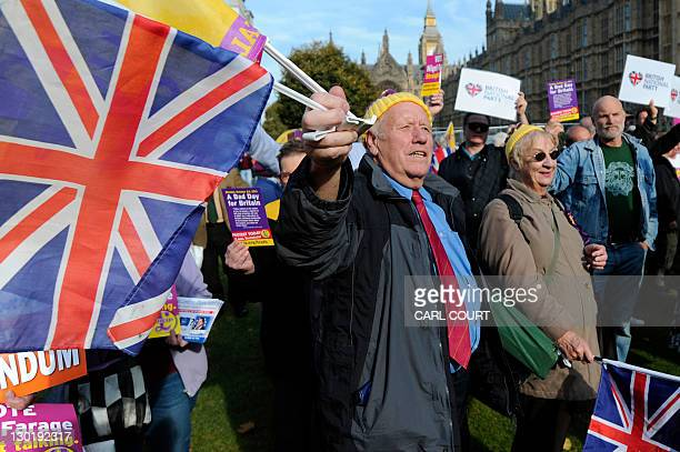 United Kingdom Independence Party supporters hold Union Jack flags as thyy take part in a demonstration outside the Houses of Parliament in central...