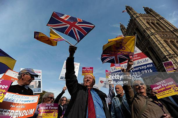 United Kingdom Independence Party supporters take part in a demonstration outside the Houses of Parliament in central London on October 24 the day...