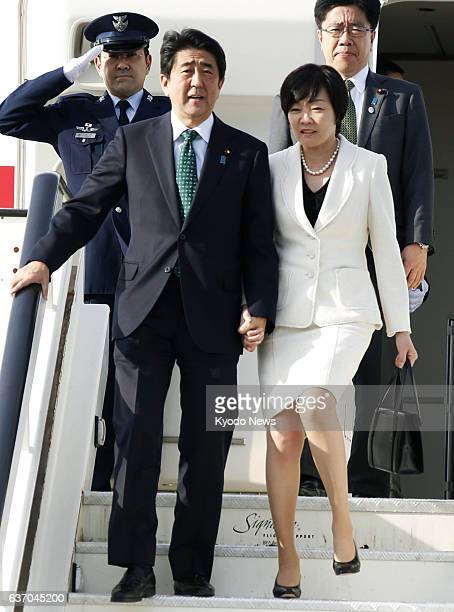 LONDON United Kingdom Japanese Prime Minister Shinzo Abe and his wife Akie arrive in London on April 30 2014 Abe was in Britain as part of his...