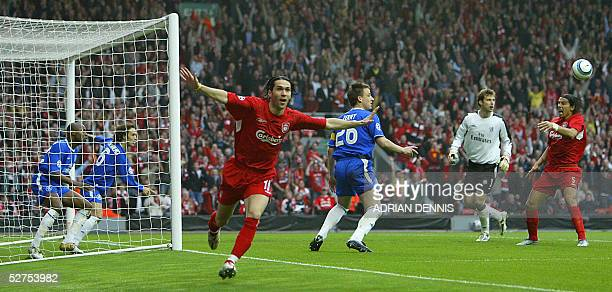 Liverpool's Luis Garcia scoring against Chelsea with teammate Milan Baros Ricardo Carvalho John Terry and goal keeper Petr Cech watch during their...
