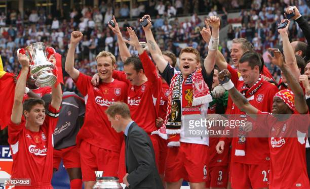 Liverpool's Steven Gerrard lifts the FA Cup with teammates as Britain's Prince William looks on after Liverpool won the English FA Cup final against...
