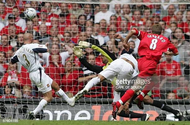 Liverpool's Steven Gerrard puts the ball past West Ham goalkeeper Shaka Hislop to score his team's secong goal during the FA Cup final at the...