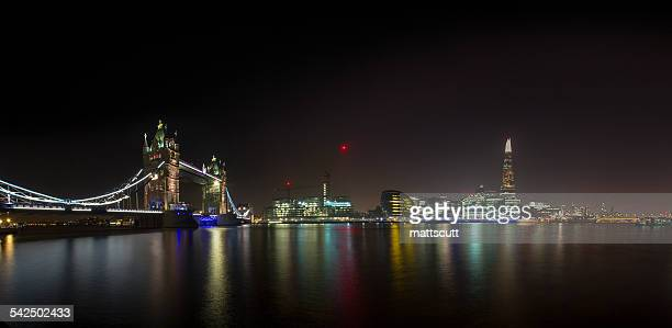United Kingdom, London, Illuminated London Bridge and Shard building by night and River Thames in foreground