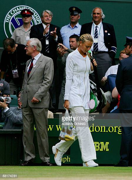 Maria Sharapova of Russia arrives on Centre Court to meet Venus Williams of the US in their semi final match at the 119th Wimbledon Tennis...