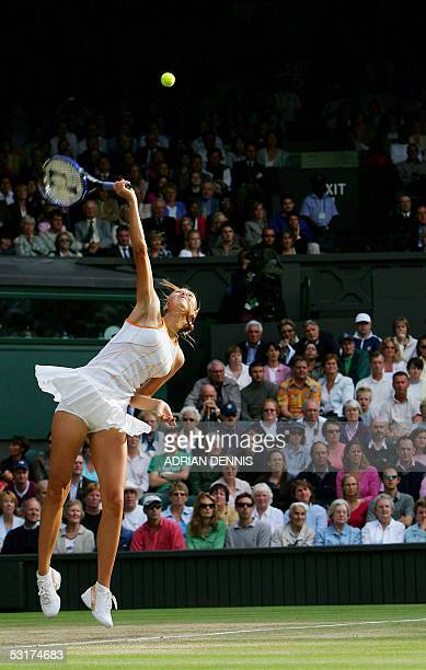 Maria Sharapova of Russia serves to Venus Williams of the US during their semi final match at the 119th Wimbledon Tennis Championships in London 30...
