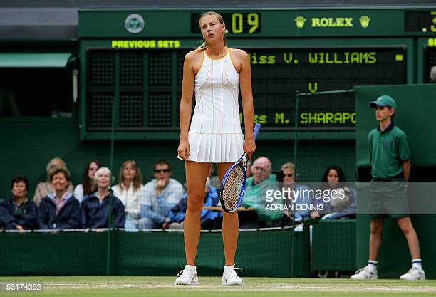 Maria Sharapova of Russia stands after losing a point to Venus Williams of the US during their semi final match at the 119th Wimbledon Tennis...