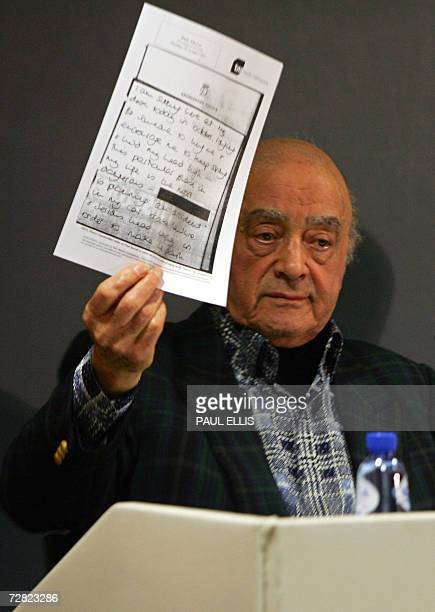 Mohamed AlFayed father of Dodi alFayed who died in a car crash with Princess Diana in 1997 holds a letter reportedly from the Princess at a press...