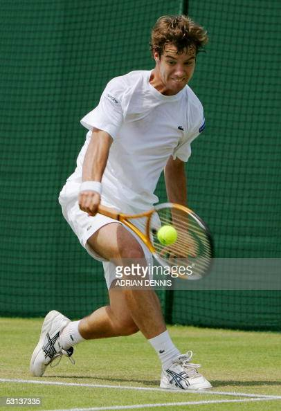 Richard Gasquet of France hits a backhand to Gilles Elseneer of Belgium during their second round match at the 119th Wimbledon Tennis Championships...