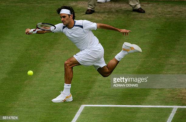 Roger Federer of Switzerland hits a fore hand to Nicolas Kiefer of Germany during their match at the 119th Wimbledon Tennis Championships in London...