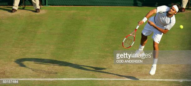 Roger Federer of Switzerland hits a shot to Juan Carlos Ferrero of Spain during their fourth round match at the 119th Wimbledon Tennis Championships...