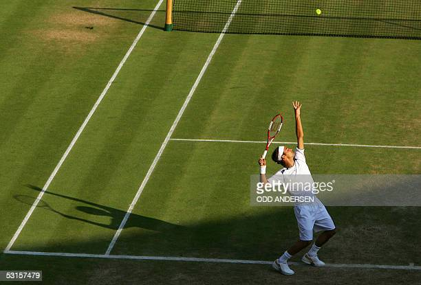Roger Federer of Switzerland serves to Juan Carlos Ferrero of Spain during their fourth round match at the 119th Wimbledon Tennis Championships in...