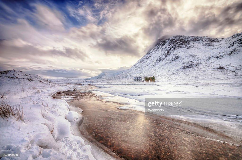 United Kingdom, Scotland, Glencoe, Solitude, house at river in winter